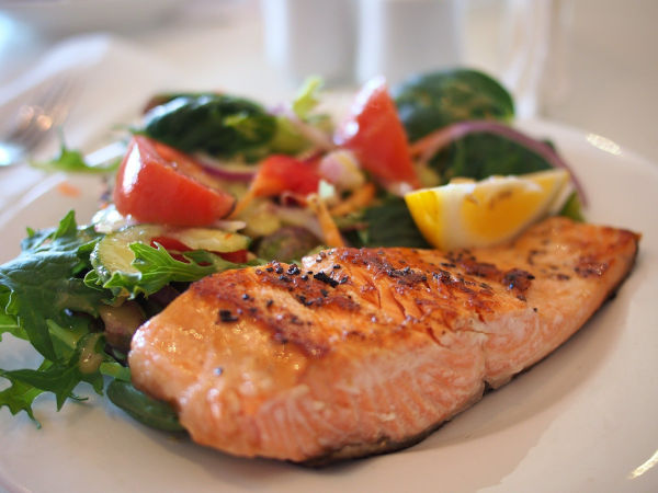 Salmon on a plate with veg.